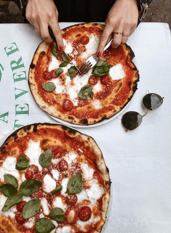 Canva - Person Slicing Pizza